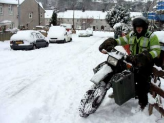 Blood Delivery in the snow on a Harley Davidson MT350