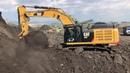 Caterpillar 352F Excavator Loading Trucks With Coal