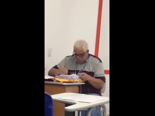 This teacher correcting exams while students are in class
