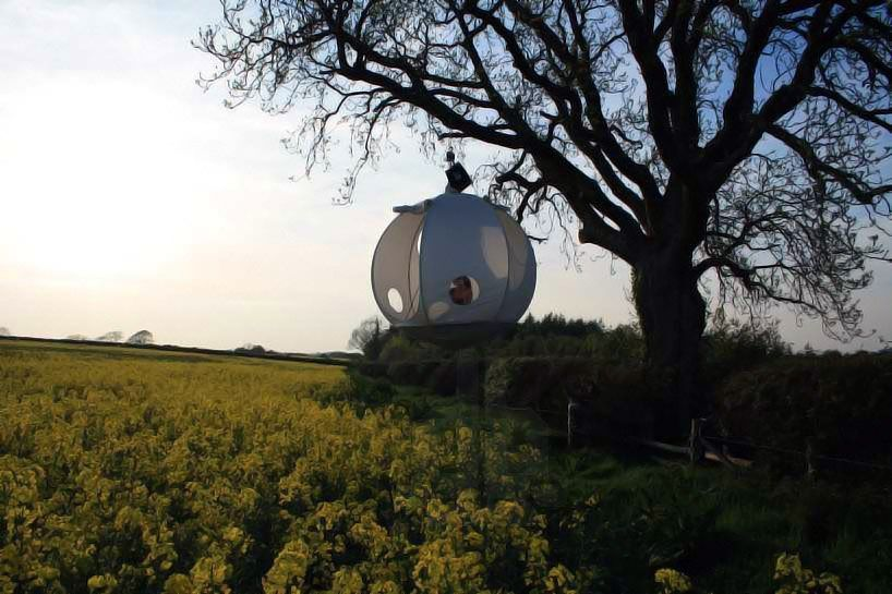 the 'roomoon' is a dwelling designed by the hanging tent company that allows campers to hoist themselves up into nature's treetops